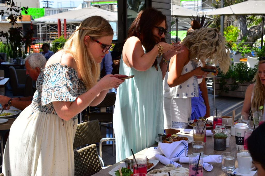 Bloggers take food pics at The Lot La Jolla